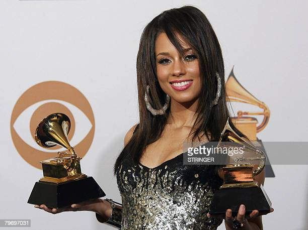 Singer Alicia Keys poses with her trophies of Best Female RB Vocal Performance and Best RB Song at the 50th Grammy Awards in Los Angeles on February...