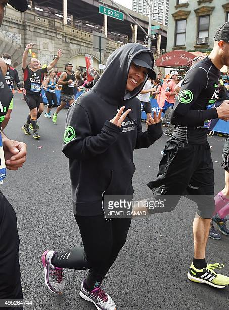 US singer Alicia Keys runs during the TCS New York City Marathon in New York on November 1 2015 AFP PHOTO/JEWEL SAMAD