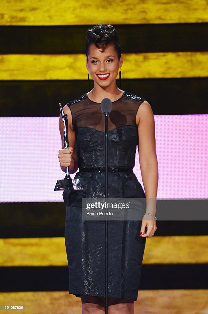 Singer <a gi-track='captionPersonalityLinkClicked' href=/galleries/search?phrase=Alicia+Keys&family=editorial&specificpeople=169877 ng-click='$event.stopPropagation()'>Alicia Keys</a> speaks onstage at BET's Black Girls Rock 2012 at Paradise Theater on October 13, 2012 in New York City.