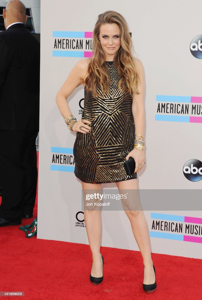 Singer Alicia Silverstone arrives at the 2013 American Music Awards at Nokia Theatre L.A. Live on November 24, 2013 in Los Angeles, California.