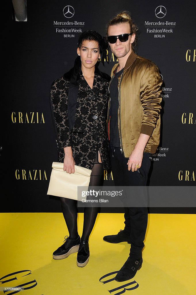 Singer Alina Sueggeler and Andreas Weizel attend the Mercedes-Benz Fashion Week Berlin Spring/Summer 2014 Preview Show by Grazia at the Brandenburg Gate on July 1, 2013 in Berlin, Germany.