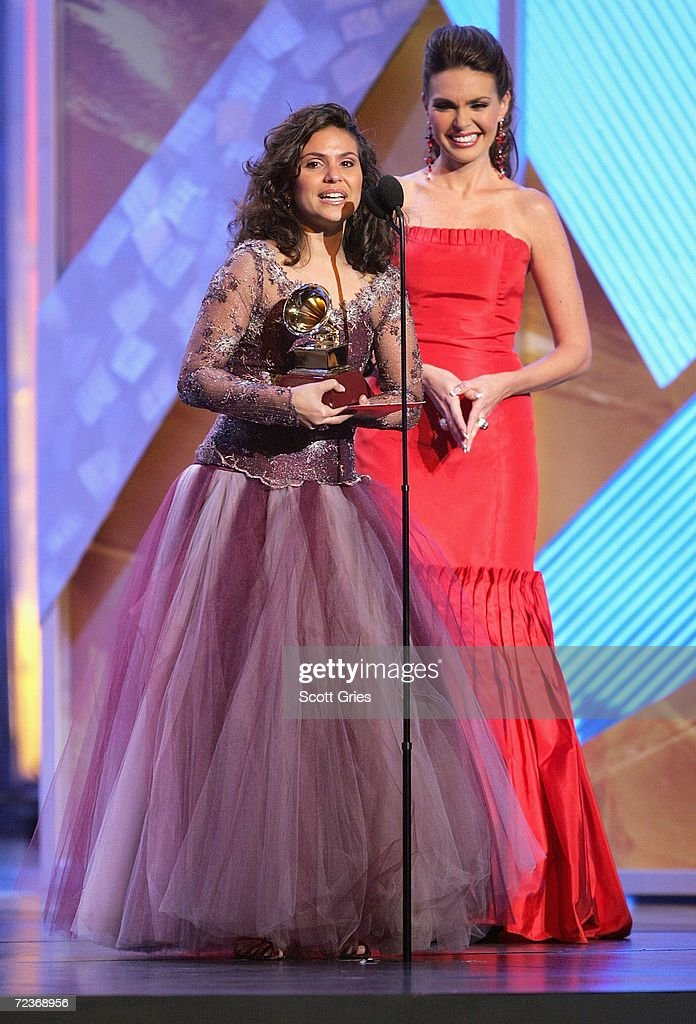 Singer Aline Barros accepts her award for 'Best Christian Album' from presenter Barbara Palacios on stage at the 7th Annual Latin Grammy Awards at Madison Square Garden November 2, 2006 in New York City.