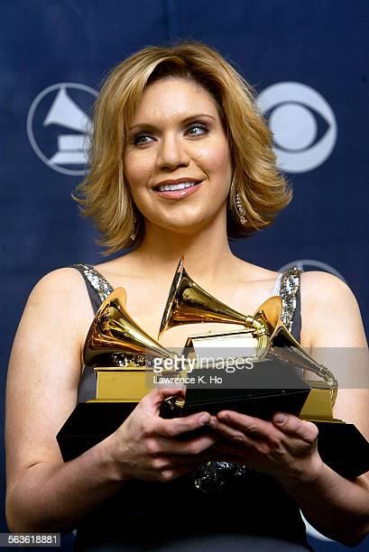 AWARDS –– Singer Alison Krauss holds her three Grammys while backstage at the 46th annual Grammy Awards in Los Angeles February 8 2004 Krauss won for...