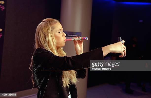 Singer Alli Simpson takes a selfie at Radio Disney's Family VIP Birthday event celebrating 18 years of Radio Disney at Club Nokia on November 22 2014...
