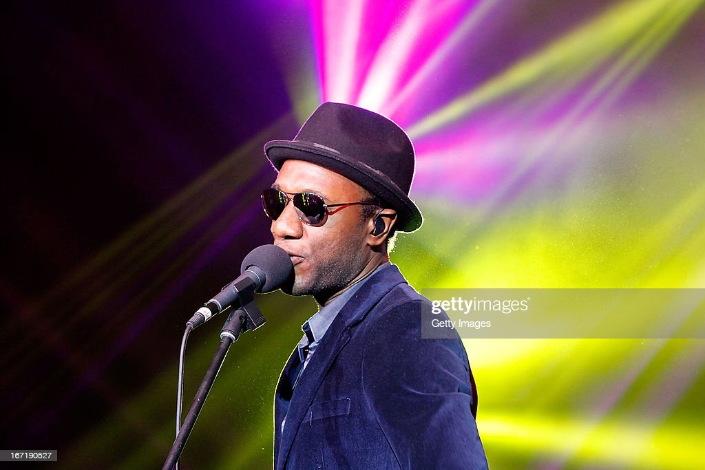 Singer <a gi-track='captionPersonalityLinkClicked' href=/galleries/search?phrase=Aloe+Blacc&family=editorial&specificpeople=4340598 ng-click='$event.stopPropagation()'>Aloe Blacc</a> performs during the exclusive 'For the Love of Cinema' event hosted by Swiss watch manufacturer IWC Schaffhausen in the role as new sponsor of the Beijing International Film Festival, at the Ming Dynasty City Wall on April 22, 2013 in Beijing, China.