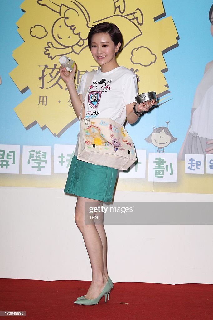 Singer Amber Kuo attends charity activity to help poor children on Monday August 19,2013 in Taipei,China.
