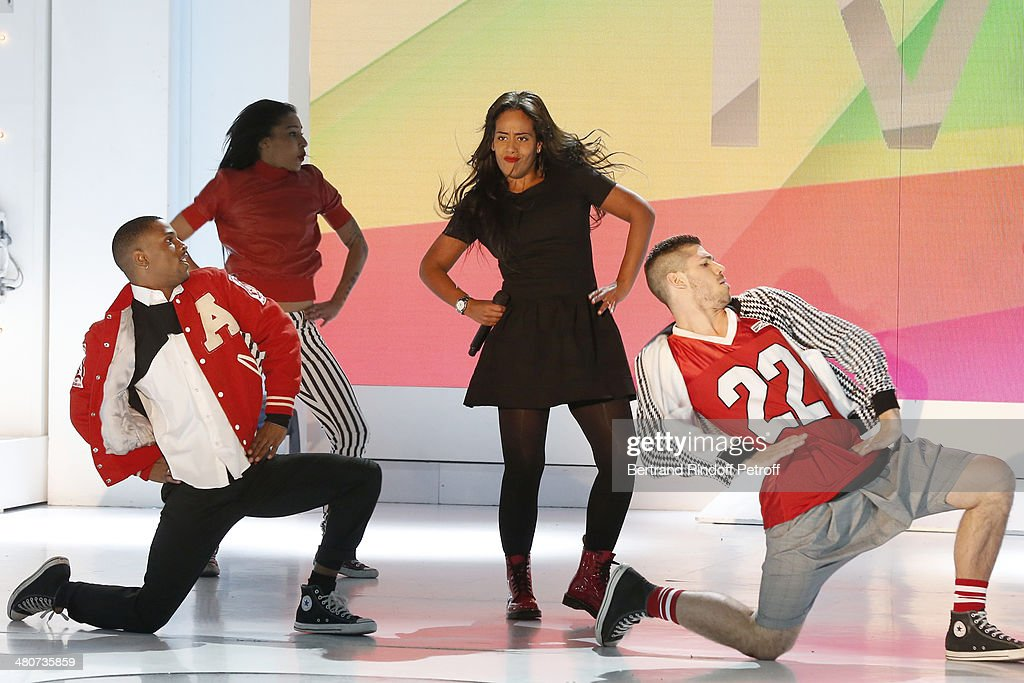 Singer Amel Bent (2nd R) and dancers performs on stage during the recording of television show host's Michel Drucker's 'Vivement Dimanche' weekly show at Pavillon Gabriel on March 26, 2014 in Paris, France.