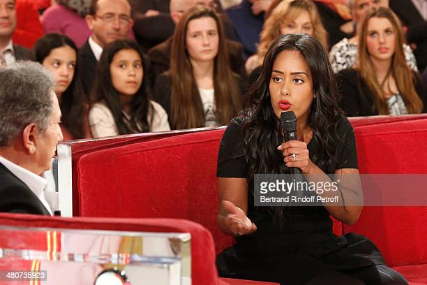 Singer Amel Bent talks with show host Michel Drucker during the recording of Drucker's 'Vivement Dimanche' weekly show at Pavillon Gabriel on March...