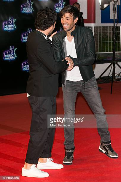 Singer Amir Haddad aka Amir and singer Enrique Iglesias attend the 18th NRJ Music Awards at Palais des Festivals on November 12 2016 in Cannes France