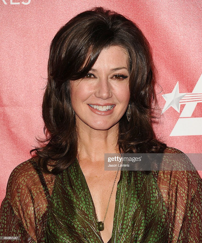 Singer Amy Grant attends the 2014 MusiCares Person of the Year honoring Carole King at Los Angeles Convention Center on January 24 2014 in Los...