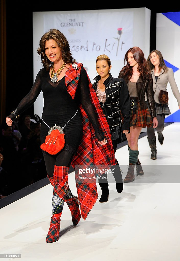 Singer Amy Grant walks the runway at the 9th Annual 'Dressed To Kilt' charity fashion show at Hammerstein Ballroom on April 5 2011 in New York City