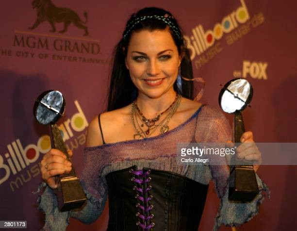 Singer Amy Lee of Evanescence poses backstage during the 2003 Billboard Music Awards at the MGM Grand Garden Arena December 10 2003 in Las Vegas...