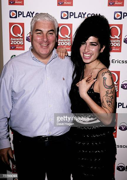 Singer Amy Winehouse and her father Mitch pose in the awards room at the Q Awards 2006 at Grosvenor House Hotel on October 30 2006 in London England