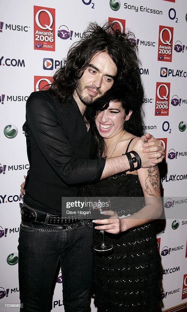 Singer Amy Winehouse and TV presenter Russell Brand pose in the awards room at the Q Awards 2006 at Grosvenor House Hotel on October 30 2006 in...
