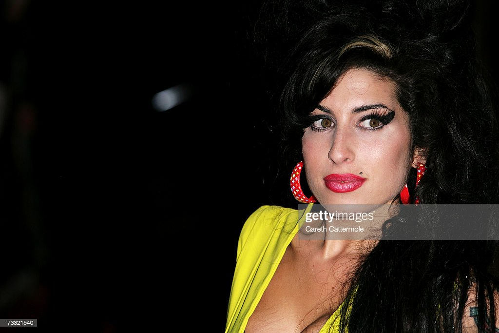 Singer <a gi-track='captionPersonalityLinkClicked' href=/galleries/search?phrase=Amy+Winehouse&family=editorial&specificpeople=201684 ng-click='$event.stopPropagation()'>Amy Winehouse</a> arrives at the BRIT Awards 2007 in association with MasterCard at Earls Court on February 14, 2007 in London.