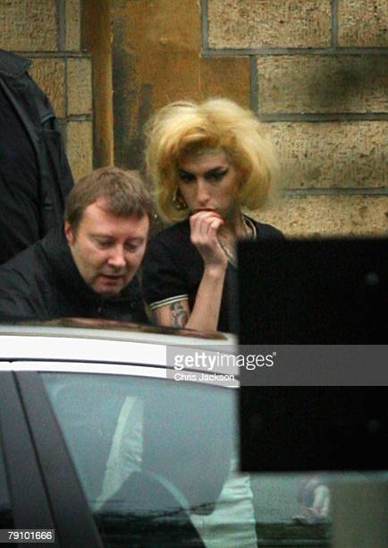 Singer Amy Winehouse leaves Snaresbrook Crown Court on January 18 2007 in East London England Winehouse was there for her husband Blake...