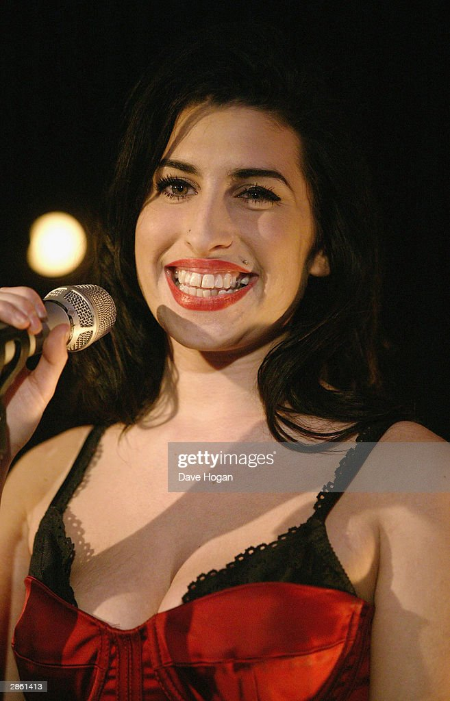 Singer Amy Winehouse performs at the announcement of the shortlist for The Brit Awards 2004 at the Park Lane Hotel on January 12, 2004 in London. The Brits Awards take place on February 17 2004.