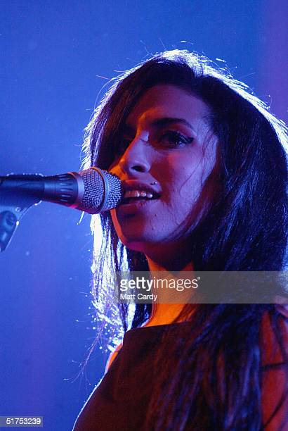 Singer Amy Winehouse performs on stage at the Bristol Academy on November 17 2004 in Bristol England