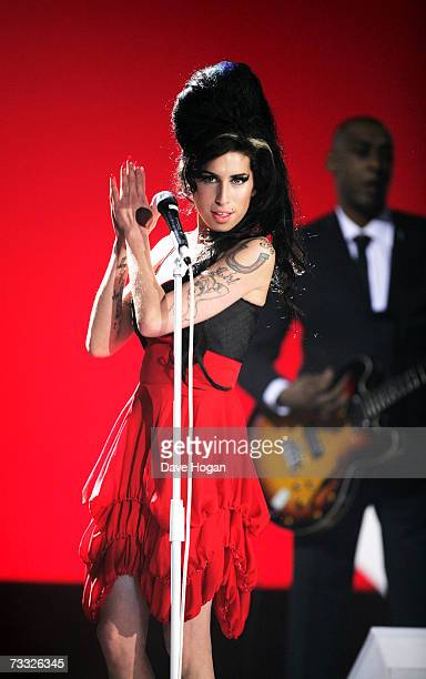 Singer Amy Winehouse performs on stage at The BRIT Awards 2007 in association with MasterCard at Earls Court 1 on February 14 2007 in London England