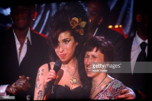 Singer Amy Winhouse hugs her mother Janis Winehouse after hearing that she won Record of the Year award for 'Back to Black' onstage during the 50th...