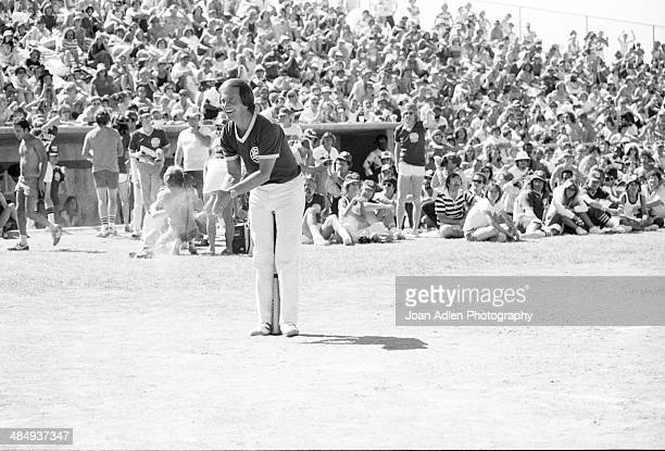 Singer an actor Pat Boone cheering on his teammates while playing ball at the Kenny Rogers Golden Nugget celebrity softball game to aid the Nevada...