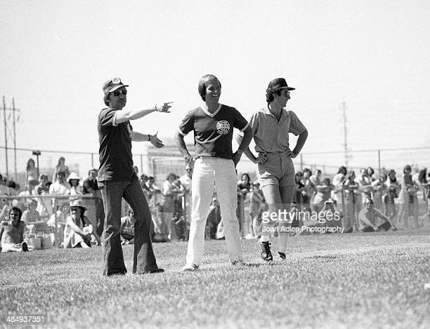 Singer an actor Pat Boone getting advise from a fellow teammate while playing ball at the Kenny Rogers Golden Nugget celebrity softball game to aid...