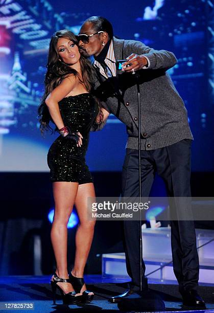 Singer Anahi and rapper Snoop Dogg onstage at the 'Los Premios MTV 2009' Latin America Awards held at Gibson Amphitheatre on October 15 2009 in...