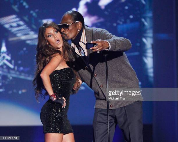 Singer Anahi and rapper Snoop Dogg onstage during the 'Los Premios MTV 2009' Latin America Awards held at Gibson Amphitheatre on October 15 2009 in...