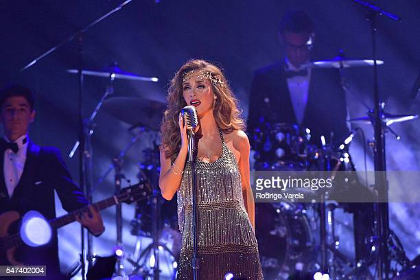 Singer Anahi performs onstage at the Univision's 13th Edition Of Premios Juventud Youth Awards at Bank United Center on July 14 2016 in Miami Florida