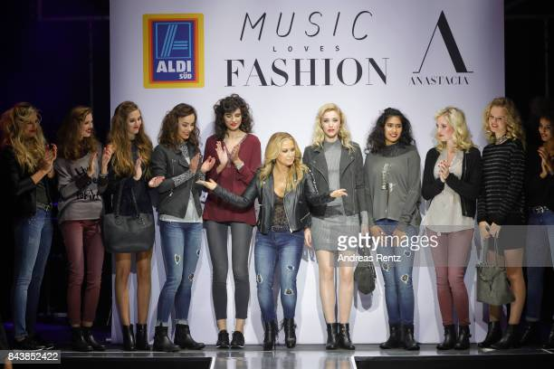 Singer Anastacia poses with models during the ALDI SUED x Anastacia collection launch 'Music loves Fashion' at EWerk on September 7 2017 in Cologne...
