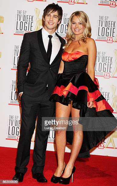 Singer and actor Dean Geyer and Margot Robbie arrive for the 51st TV Week Logie Awards at the Crown Towers Hotel and Casino on May 3 2009 in...