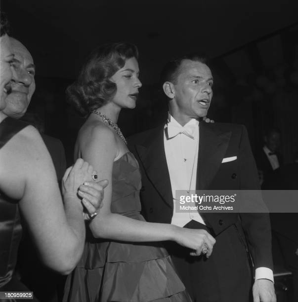 Singer and actor Frank Sinatra and actress Lauren Bacall attend the after party for the 27th Academy Awards on March 30 1955 in Los Angeles California