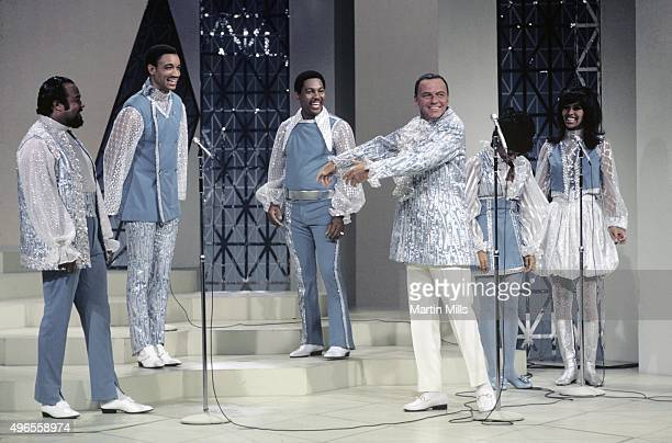 Singer and actor Frank Sinatra and The 5th Dimension perform on the television special 'Francis Albert Sinatra Does His Thing' on August 15 in Los...