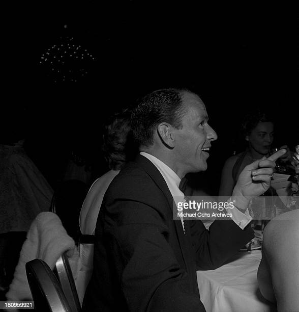 Singer and actor Frank Sinatra chats with guests at the premiere party for 'A Star is Born' on September 29 1954 in Los Angeles California