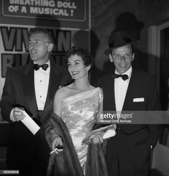Singer and actor Frank Sinatra poses with costar Jean Simmons and husband Stewart Granger at the premiere of the film 'Guys and Dolls' on November 22...