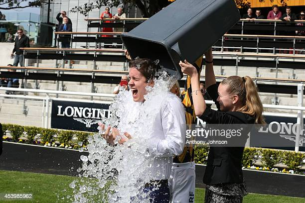 Singer and actor Johnny Ruffo does the Ice Bucket Challenge during Sydney Racing at Royal Randwick Racecourse on August 23 2014 in Sydney Australia