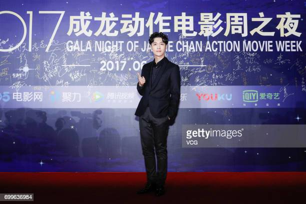 Singer and actor Lay Zhang Yixing arrives at the red carpet of Gala Night of Jackie Chan Action Movie Week during the 20th Shanghai International...