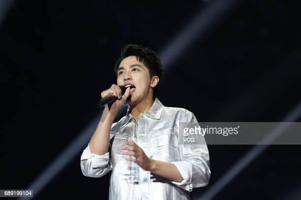 Singer and actor Xu Weizhou performs onstage during Yingke gala on May 27 2017 in Beijing China