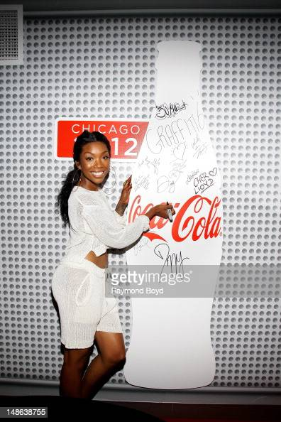 Singer and actress Brandy poses for photos in the WGCIFM 'CocaCola' Lounge in Chicago Illinois on JULY 17 2012