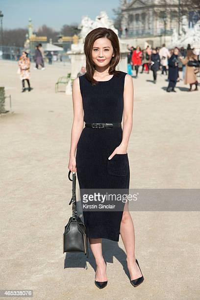 Singer and actress Charlene Choi wears Carven dress belt and bag and Christian Louboutin shoes on day 3 of Paris Collections Women on March 05 2015...