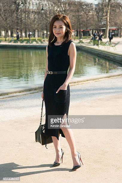 Singer and actress Charlene Choi wears Carven dress belt bag and Christian Louboutin shoes on day 3 of Paris Collections Women on March 05 2015 in...