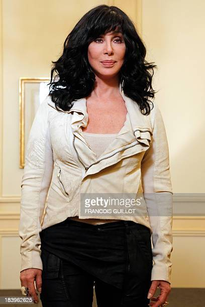 US singer and actress Cher poses on October 10 2013 in Paris AFP PHOTO FRANCOIS GUILLOT