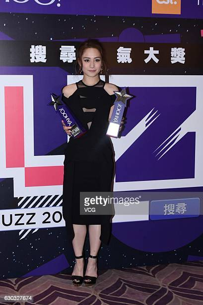 Singer and actress Gillian Chung poses with trophy during 2016 Yahoo Asia Buzz Awards Ceremony on December 20 2016 in Hong Kong China