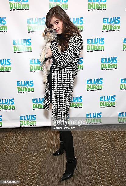 Singer and actress Hailee Steinfeld poses with Elvis Duran's dog 'Max' during 'The Elvis Duran Z100 Morning Show' at Z100 Studios on March 3 2016 in...