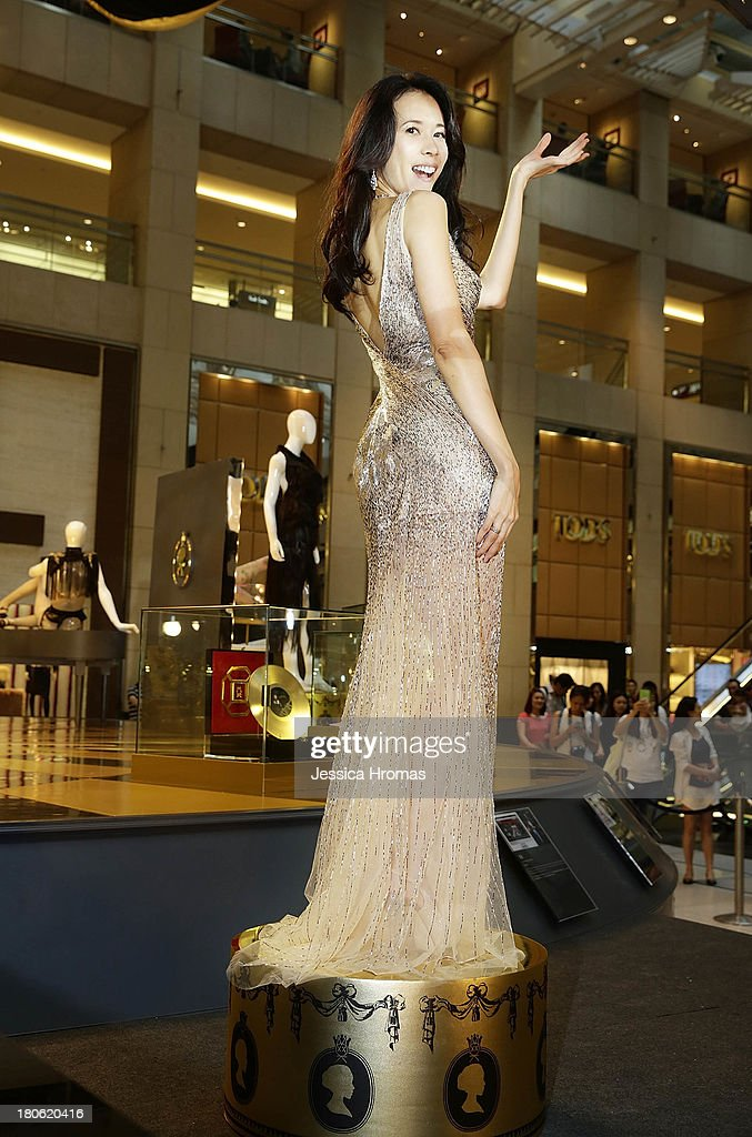 Singer and actress Karen Mok poses at the opening of the Karen Mok 20th Anniversary Exhibition opening at the Landmark building, Central on September 15, 2013 in Hong Kong, Hong Kong.