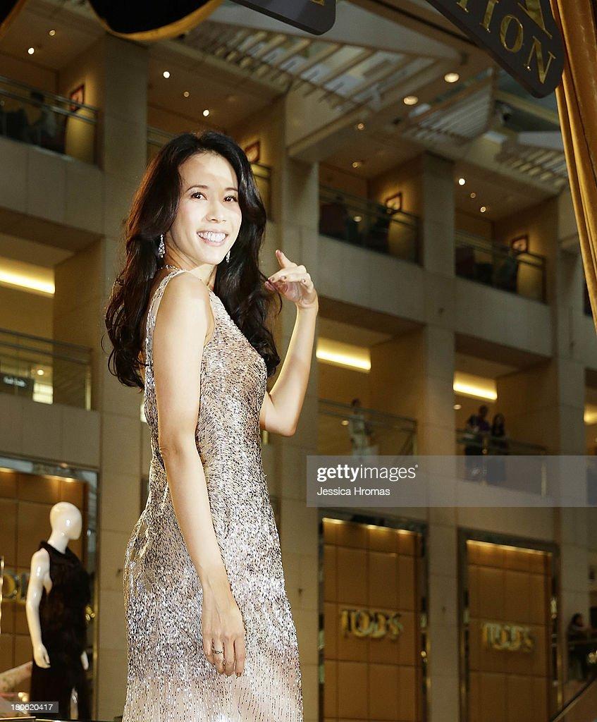 Singer and actress Karen Mok poses at the opening of the Karen Mok 20th Anniversary Exhibition opening at the Landmark building, Central on September 15, 2013 in Hong Kong, Hong Kong.