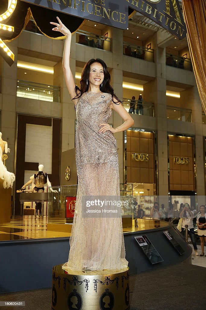 Singer and actress <a gi-track='captionPersonalityLinkClicked' href=/galleries/search?phrase=Karen+Mok&family=editorial&specificpeople=574429 ng-click='$event.stopPropagation()'>Karen Mok</a> poses at the opening of the <a gi-track='captionPersonalityLinkClicked' href=/galleries/search?phrase=Karen+Mok&family=editorial&specificpeople=574429 ng-click='$event.stopPropagation()'>Karen Mok</a> 20th Anniversary Exhibition opening at the Landmark building, Central on September 15, 2013 in Hong Kong, Hong Kong.