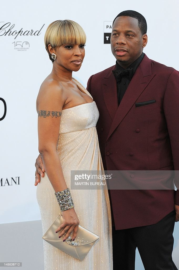 US singer and actress Mary J. Blige and Kendu Isaacs pose while arriving at amfAR's Cinema Against Aids 2010 benefit gala on May 20, 2010 in Antibes, southeastern France.