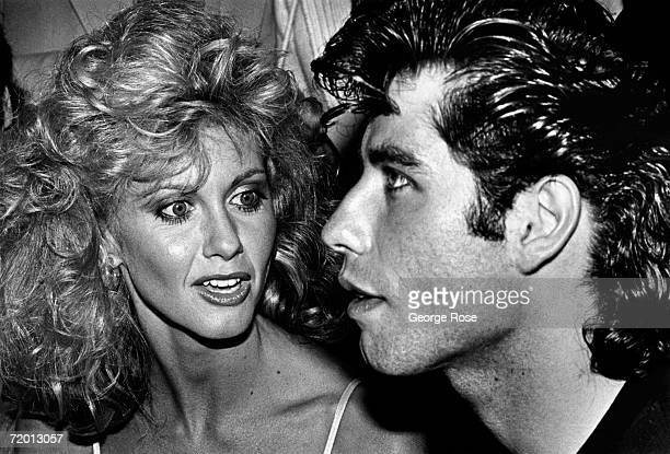 Singer and actress Olivia NewtonJohn and costar John Travolta attend their 1978 Hollywood California premiere of 'Grease' Produced by Alan Carr...