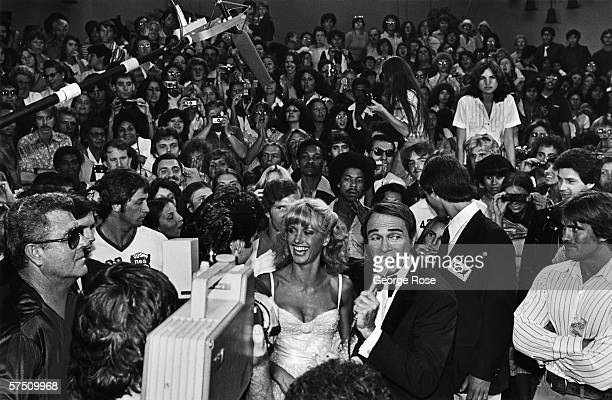 Singer and actress Olivia NewtonJohn is interviewed by red carpet emcee Army Archerd at the 1978 Hollywood California film premiere of 'Grease' The...